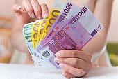 Money in womens hands
