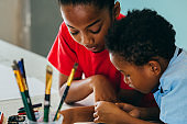 African American kids drawing and painting