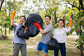 Group of Asian people with garbage bags