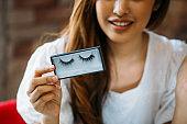 Woman showing decorative eyelashes