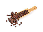 Wooden scoop of roasted coffee beans on white