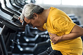 Old man heart attack in fitness gym