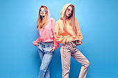 Two hipster Girl Having Fun in Stylish neon Outfit