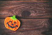 Pumpkin Halloween gingerbread cookies on rustic wooden table