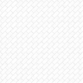 Abstract geometric pattern of crossing thin straight lines looking like brickwork placed diagonally. Stylish texture background in gray color. Seamless linear pattern.