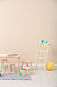 Stylish child's room interior with toys and new furniture, space for text
