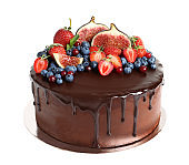 Fresh delicious homemade chocolate cake with berries on white background