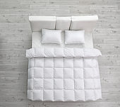 Comfortable bed with new mattress in room, above view. Healthy sleep