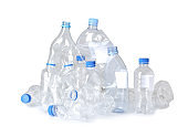 Crumpled plastic bottles on white background. Recycling problem