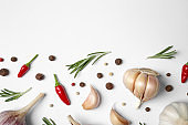 Composition with garlic, rosemary and peppers on white background, top view. Space for text
