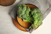 Plates with fresh broccoli on table, top view. Types of cabbage