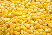 Tasty ripe corn kernels as background, closeup