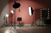 Different professional lighting equipment in modern photo studio