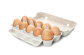 Carton of raw chicken eggs on white background