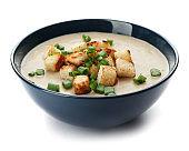 Bowl of fresh homemade mushroom soup on white background
