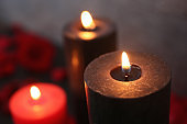 Burning black and red candles, closeup view