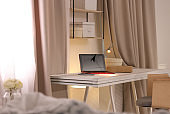 Workplace with laptop in stylish apartment. Room interior