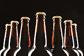 Many bottles of beer on dark background