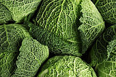 Fresh green savoy cabbages as background, top view