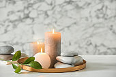 Composition with spa stones and candles on table. Space for text