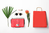 Stylish flat lay composition with shopping bag on white background