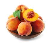 Bowl with fresh sweet peaches on white background