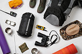 Flat lay composition with camping equipment on white background