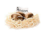 Golden eggs and card with word PENSION in nest on white background