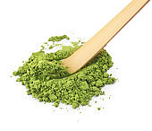 Powdered matcha tea and bamboo chashaku on white background