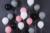 Bright balloons near color wall. Festive decoration