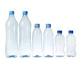 Empty plastic bottles on white background. Recycling problem