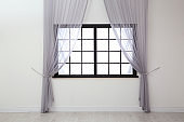 Modern window with curtains in room. Home interior