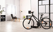 Light living room interior with modern bicycle