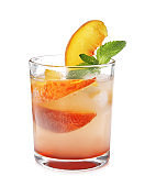 Peach cocktail in glass on white background. Refreshing drink