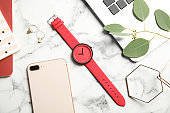 Flat lay composition with stylish wrist watch on marble background. Fashion accessory