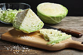 Cutting board with chopped and sliced cabbage on table