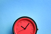 Stylish bright wrist watch on color background, top view with space for text. Fashion accessory