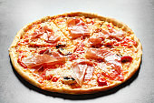 Delicious pizza with bacon on grey background