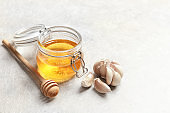 Jar with honey and garlic as cold remedies on table