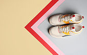 Pair of sports shoes on color background, top view. Space for text