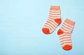 Cute child socks on color background, flat lay. Space for text
