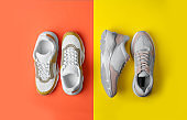 Flat lay composition of woman training shoes on color background