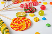 Many different candies on white background, closeup view