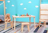 Beautiful child room interior with wooden furniture and toys