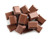 Pieces of tasty milk chocolate on white background, top view