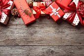 Beautiful composition with gift boxes and Christmas decorations on wooden background, top view