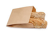 Paper bag with bread loaves on white background. Space for design