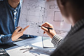 Business meeting construction engineer discussing architect plan