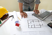 Blueprints of designer and engineers working at architects office.