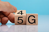Hand Changing Wooden Block From 4g To 5g